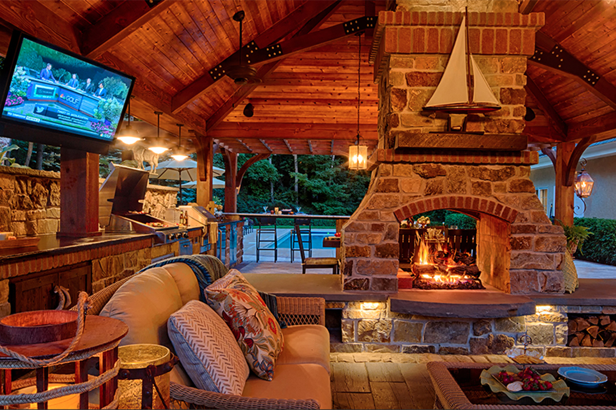 Outdoor kitchen with peer through stone and brick fireplace