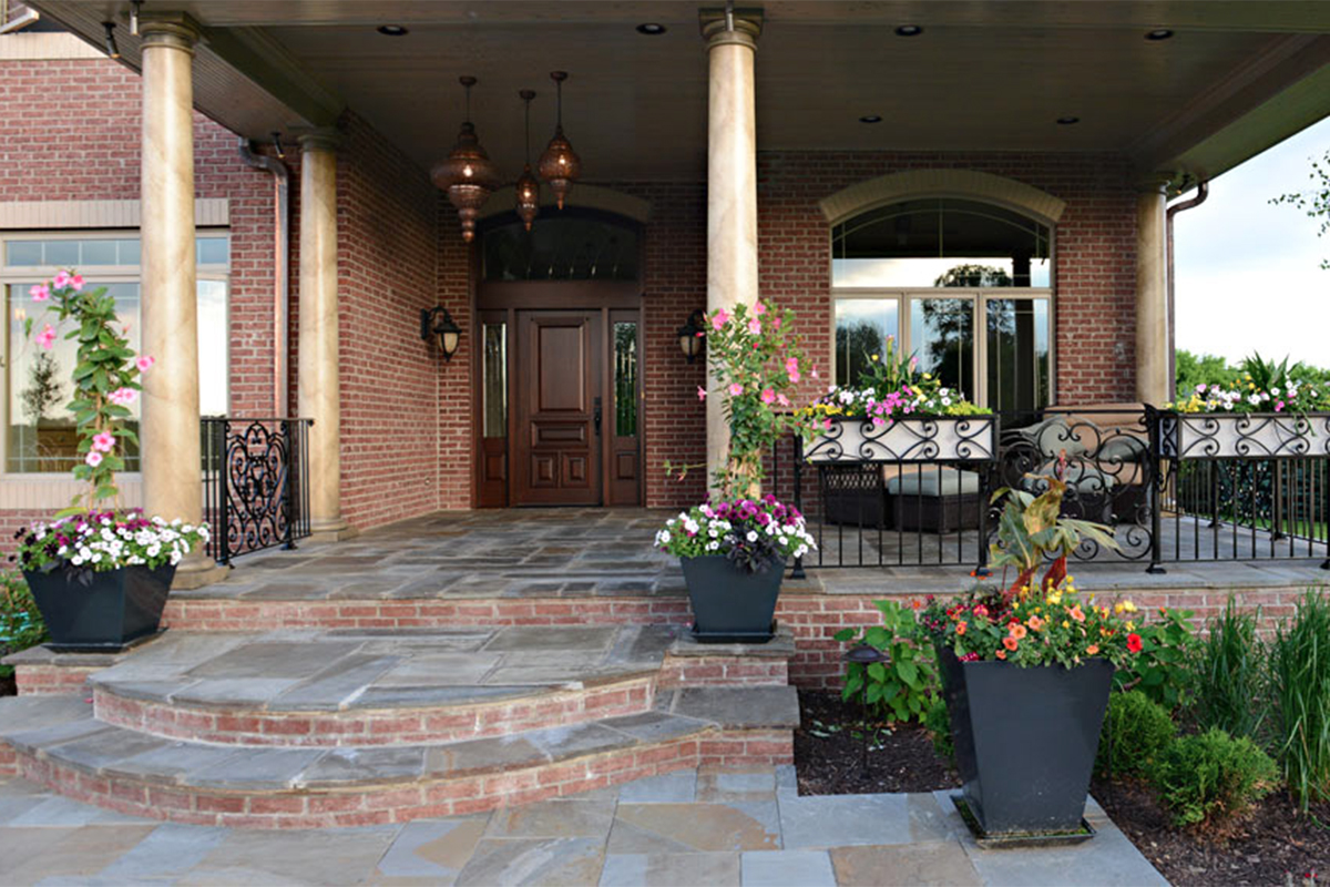 Grand entry of slate and brick with marble pillars