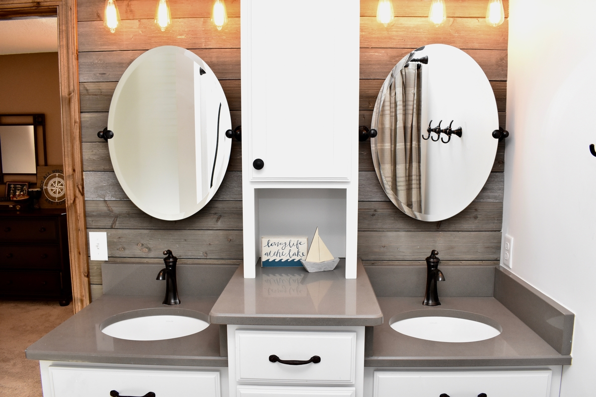 lake inspired, floating mirrors,  barnwood-like wall covering, oil-rubbed bronze faucet