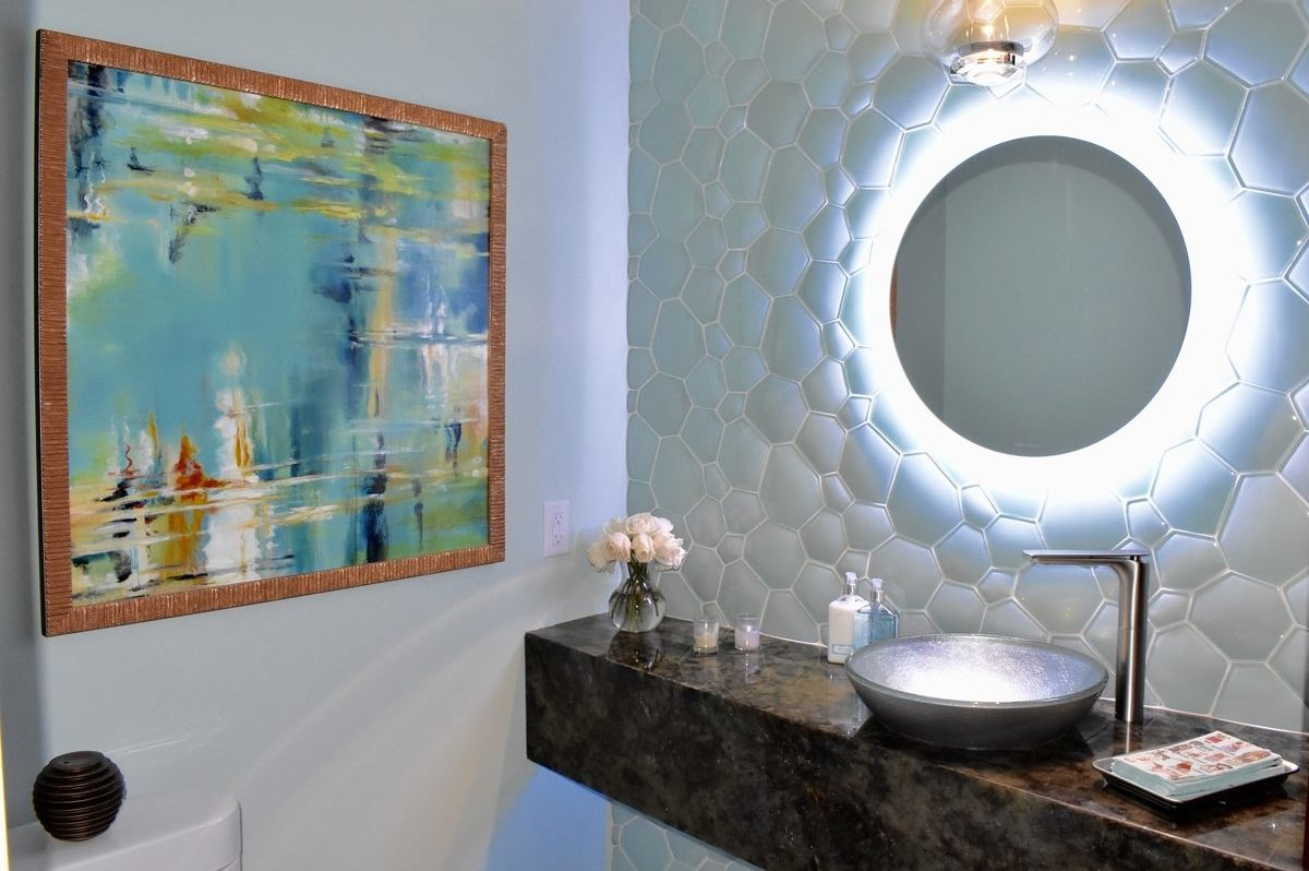 glass tiled accent wall with back-illuminated mirror