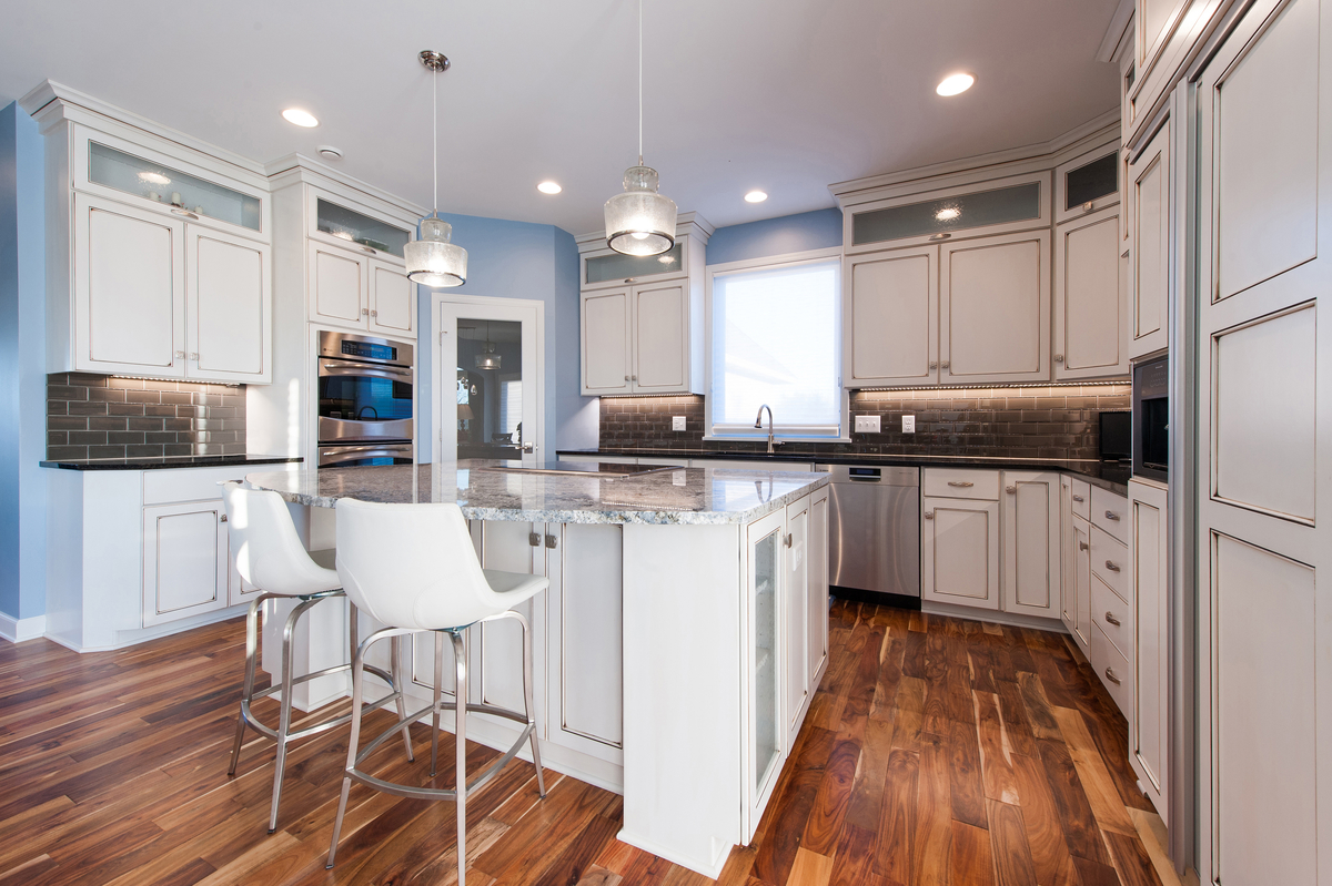 Eat-in kitchen mixes traditional and contemporary styling, features LED under cabinet lighting