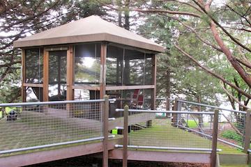 Multi-level deck retreat with screen porch