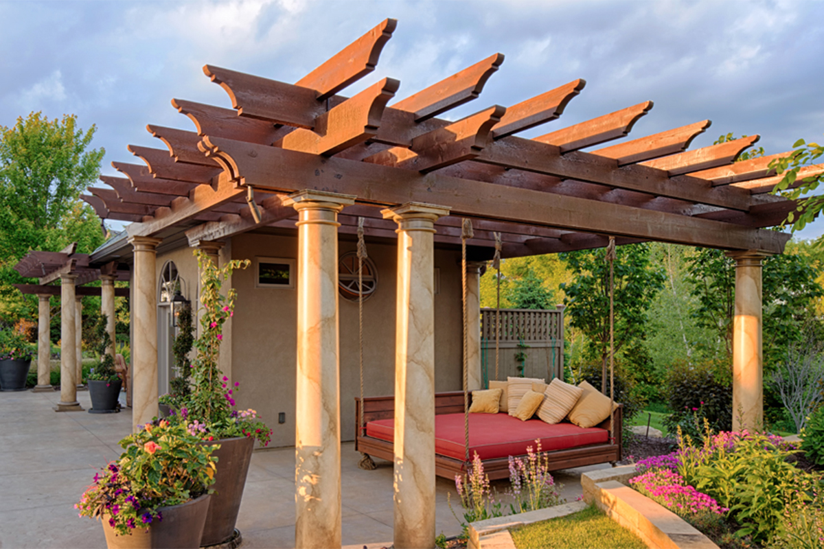 Pergola adorned pool house for entertaining and relaxation