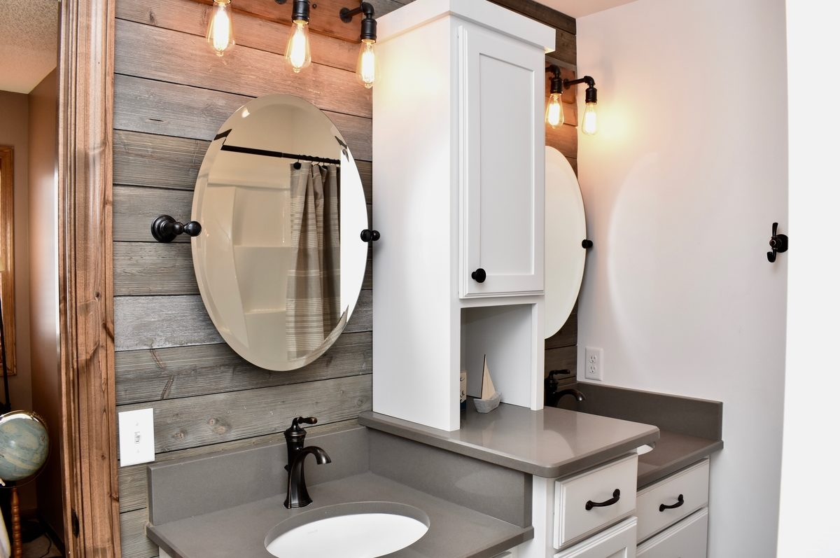 lake inspired, floating mirrors, barnwood-like wall covering, industrial lighting